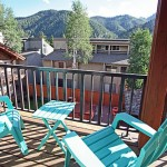 Adirondack chairs on upper deck with views of Baldy