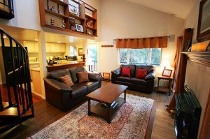 Comfortable living room with HD TV and BluRay, gas fireplace, and balcony